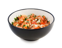 The salsa pico de gallo in a black bowl isolateed on white Stock Images