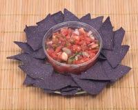 Salsa pico de gallo and blue corn tortilla chips Royalty Free Stock Images