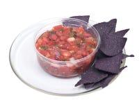 Salsa pico de gallo and blue corn tortilla chips Royalty Free Stock Photo