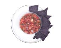 Salsa pico de gallo and blue corn tortilla chips Stock Photos