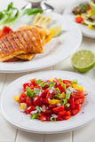 Salsa salad with grilled cheese Stock Images