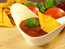 Salsa sauce with dipped nacho Stock Images