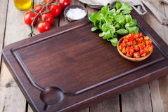 Salsa sauce and ingredients with fresh salad Dark steak cutting bord wooden background Copy space. Salsa sauce and ingredients with fresh salad Dark steak stock photos