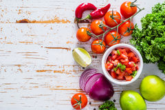 Salsa sauce and ingredients. On wood background, copy space stock photos