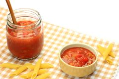Salsa source and penne Stock Photos
