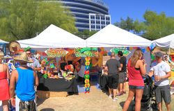 USA, Arizona: Salsa Booth and Customers Stock Image