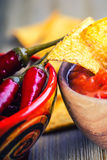 Salsa with tortilla chips and chilli peppers.Concept. Salsa with tortilla chips and chilli peppers Royalty Free Stock Photography