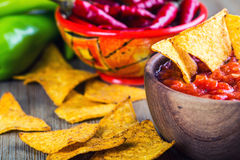 Salsa with tortilla chips and chilli peppers.Concept Royalty Free Stock Image