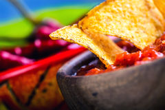 Salsa with tortilla chips and chilli peppers.Concept. Salsa with tortilla chips and chilli peppers Royalty Free Stock Photos