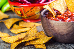 Salsa with tortilla chips and chilli peppers.Concept. Salsa with tortilla chips and chilli peppers Royalty Free Stock Images