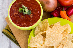 Salsa and Tortilla Chips Mexican Food Snack. Tortilla chips and salsa snack food with vegetables stock photography