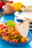 Salsa with tortilla chips. Tortilla chips with spicy tomato salsa,Mexican food royalty free stock image
