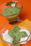 Salsa verde and cottage cheese sauce. In glass bowl stock photo