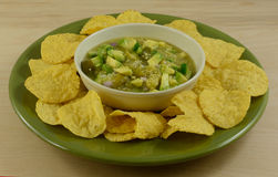 Salsa verde guacamole mixture with chips royalty free stock image