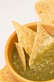 Salsa Verde. Macro. Salsa Verde with tortilla chips royalty free stock photography