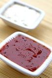 Salsas del tomate y de ajo Imagenes de archivo