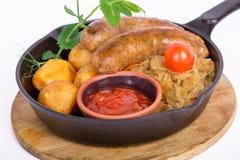 Salsicce di maiale arrostite con la patata Immagine Stock Libera da Diritti