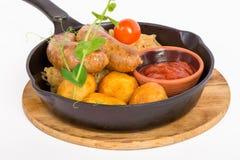 Salsicce di maiale arrostite con la patata Immagini Stock