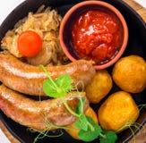 Salsicce di maiale arrostite con la patata Fotografie Stock
