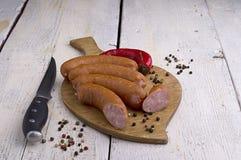 Salsiccia, granelli di pepe e peperoncino rosso Fotografia Stock Libera da Diritti