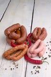 Salsiccia, granelli di pepe e peperoncino rosso Immagini Stock
