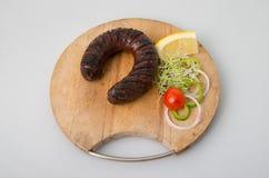 Salsiccia arrostita con il pomodoro Fotografia Stock