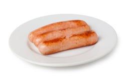 Salsiccia arrostita sul piatto isolato su bianco Immagine Stock