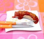 Salsiccia con ketchup Immagine Stock