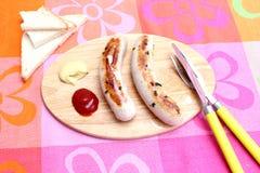 Salsiccia con ketchup Immagini Stock