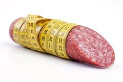 Salsiccia con nastro adesivo di misurazione Immagine Stock