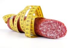 Salsiccia con nastro adesivo di misurazione Fotografie Stock