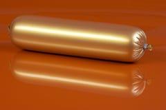 Salsiccia cotta dorata su colore marrone Fotografie Stock Libere da Diritti