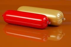Salsiccia cotta su colore marrone Immagini Stock Libere da Diritti