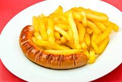Salsiccia fritta con le patate fritte Fotografie Stock