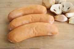 Salsiccia, fungo ed aglio Fotografia Stock