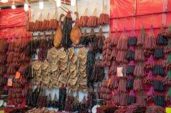 Salsiccie cinesi ed anatra asciutte Immagine Stock