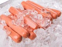 Salsiccie con i cubetti di ghiaccio I Fotografia Stock