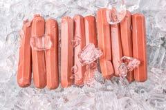 Salsiccie con i cubetti di ghiaccio VII Fotografia Stock