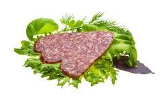 Salsiccie con insalata e basilico Immagine Stock Libera da Diritti