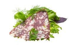 Salsiccie con insalata e basilico Fotografia Stock