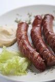 Salsiccie cotte con senape immagine stock