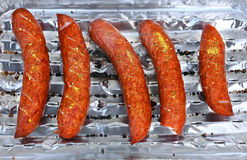 Salsiccie del barbecue su una griglia Fotografie Stock