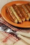 Salsiccie della griglia del barbecue Immagini Stock