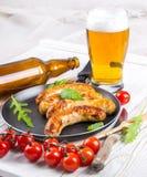 Salsiccie di Monaco di Baviera con i pomodori Fotografia Stock