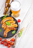 Salsiccie di Monaco di Baviera con i pomodori Immagine Stock Libera da Diritti