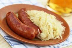Salsiccie e cavolo Fotografia Stock