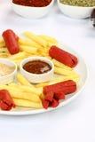 Salsiccie e patate fritte Immagine Stock