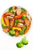 Salsiccie e verdure cotte Fotografie Stock Libere da Diritti