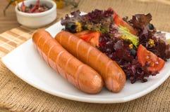 Salsiccie e verdure cotte Fotografia Stock Libera da Diritti