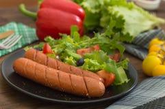 Salsiccie e verdure cotte Immagine Stock